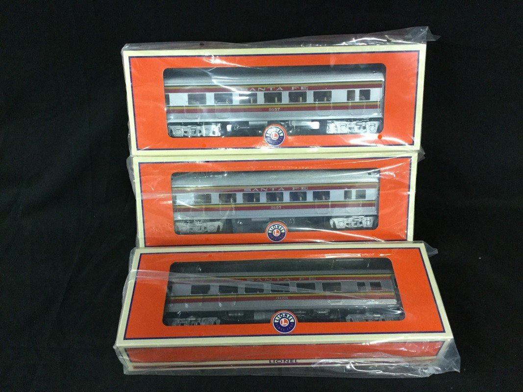 Three Lionel coach cars