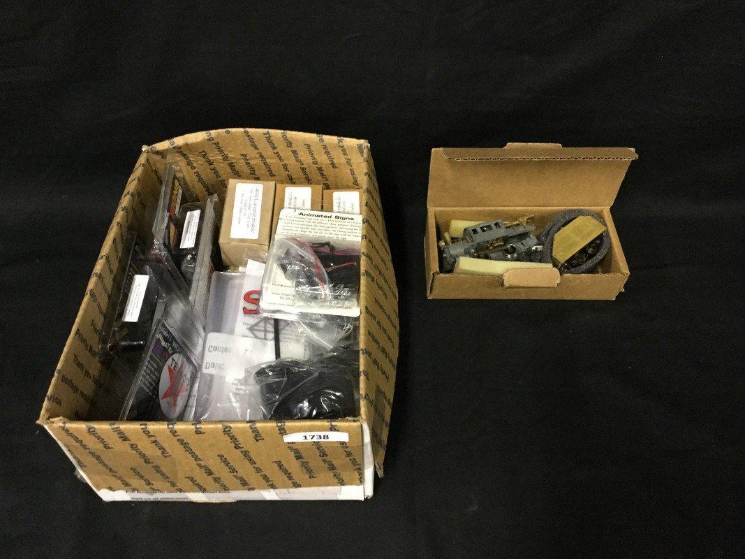 Box of model train electronics