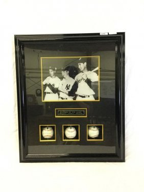 Framed baseball memorabilia of DiMaggio, Mantle, and