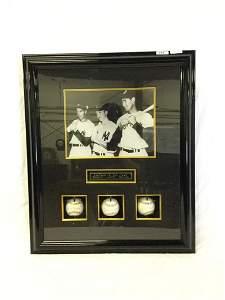Framed baseball memorabilia of DiMaggio, Mantle, and