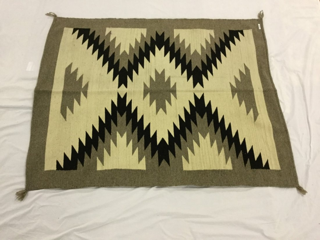 Decorative rugs in the Ganado/ Navaho style
