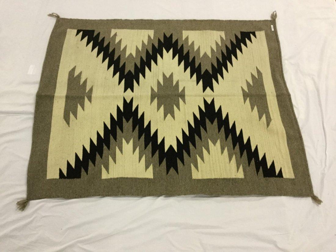 Decorative rugs in the Ganado/ Navaho style