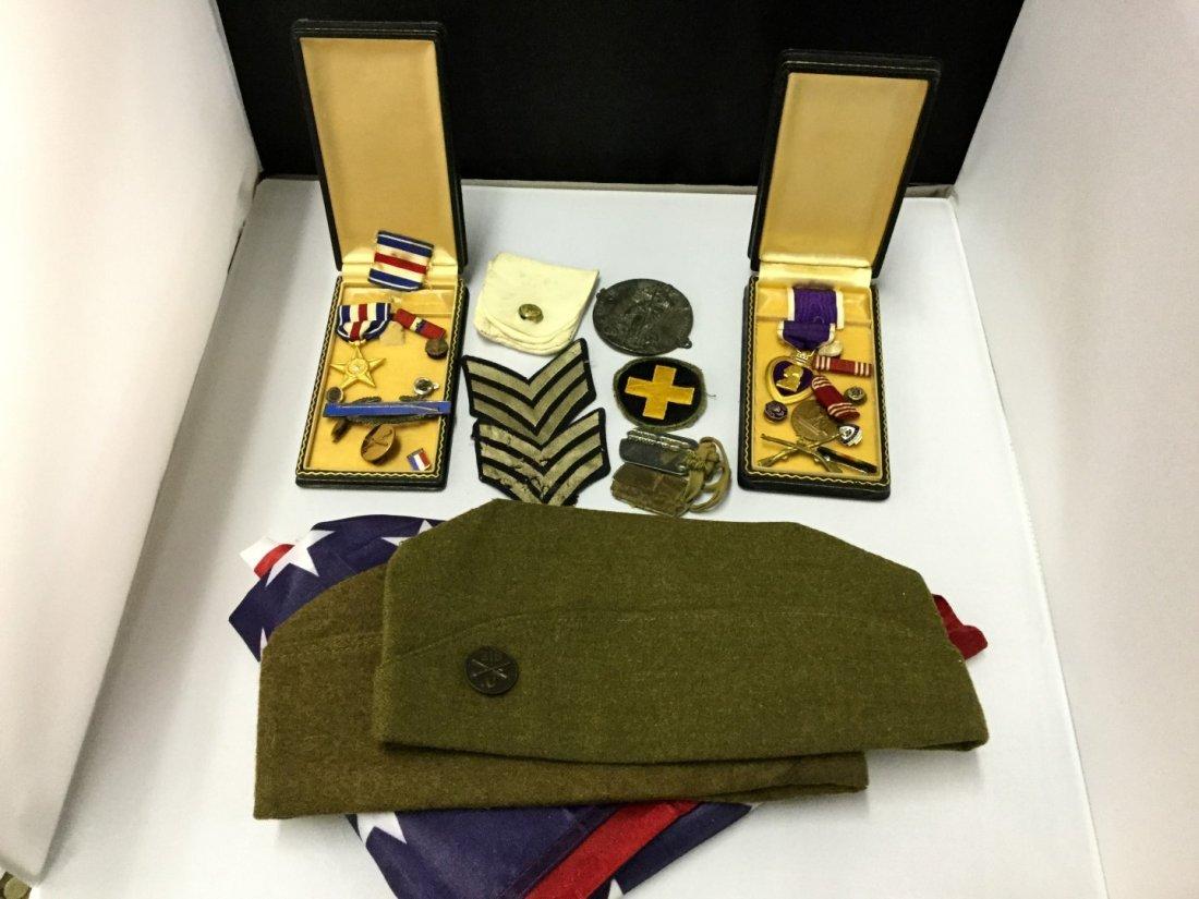 WWII memorabilia a silver star, purple heart, conduct