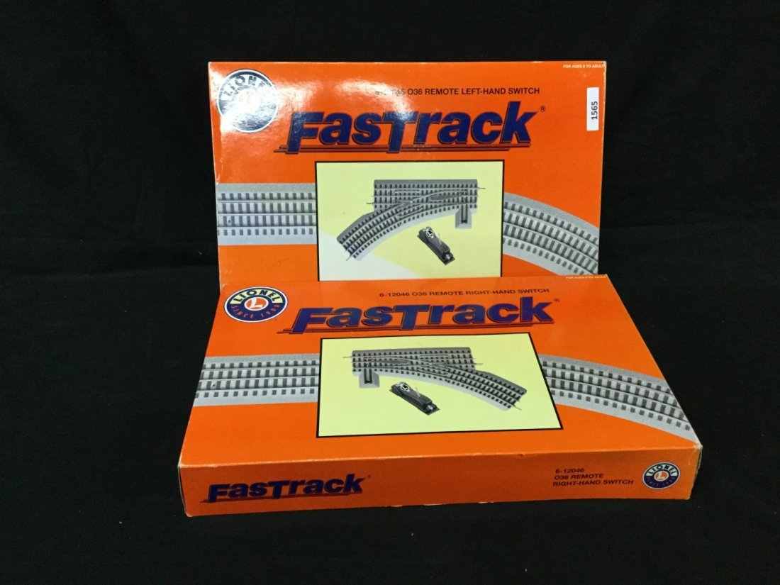 Two boxes boxes of Lionell fast track O36 gauge remote