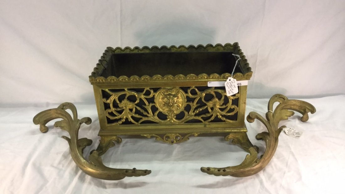 Pair of gilt bronze mounts and gilt lined planter