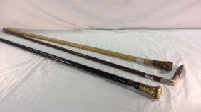 Three vintage walking sticks