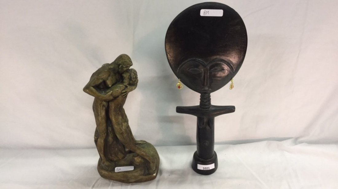 Sculpture of two people and woman
