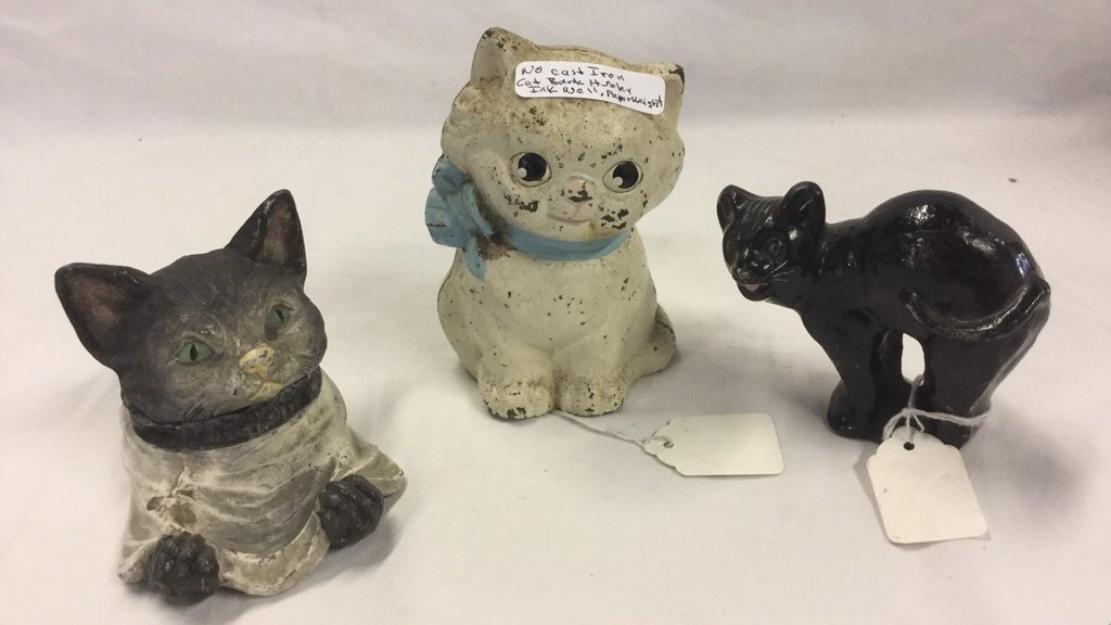 Cast-iron cat paperweights and inkwell