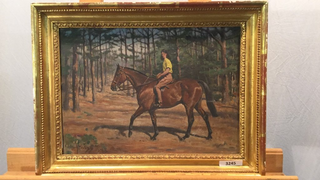 Framed oil on board of woman riding horse