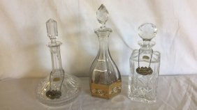 Three crystal decanters with sterling nameplates