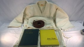 Judo gi with two books