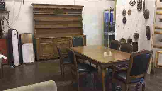 Dining table with six leather chairs and sideboard