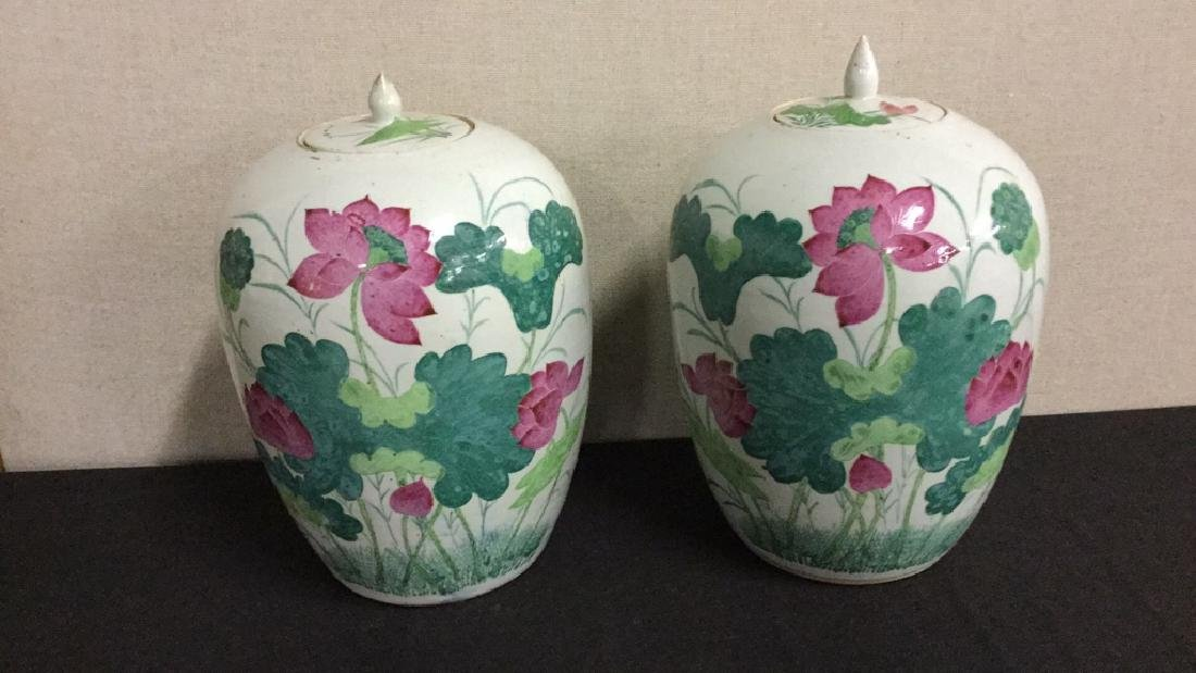 Two painted Asian earthenware jars