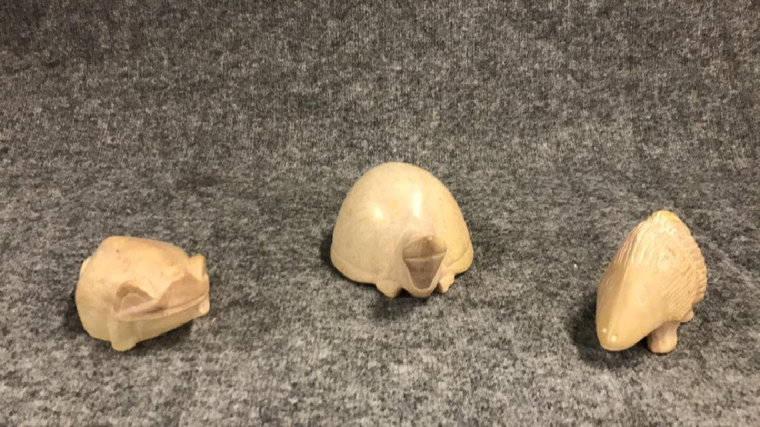 Three carved soapstone animals