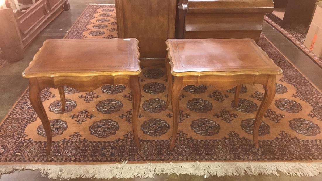 Two leather top side tables