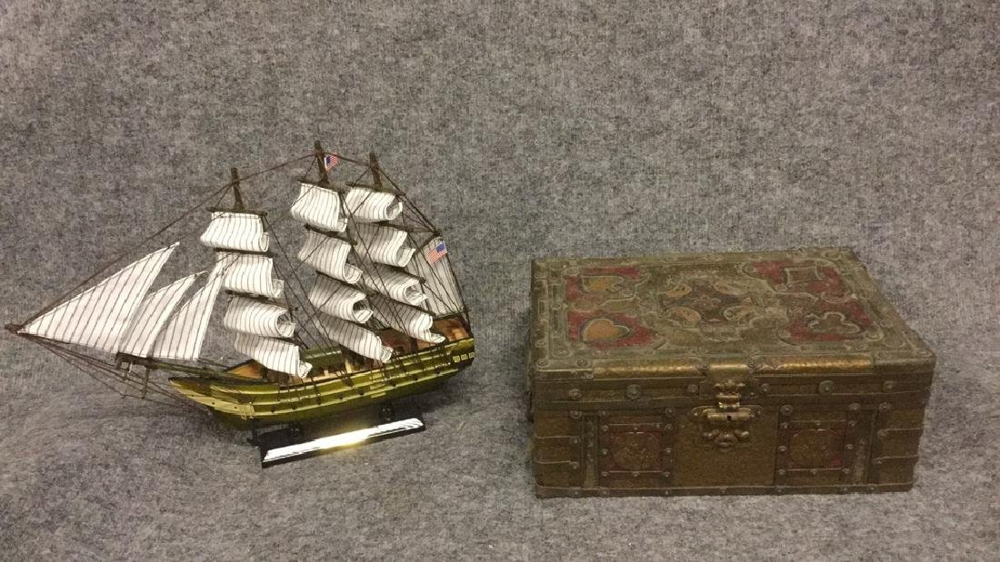 Small metal poker set and Model sailing ship