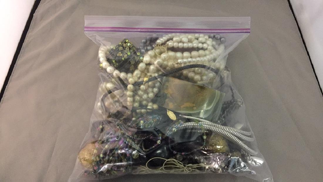 Bag of Assorted Necklaces and Jewelry
