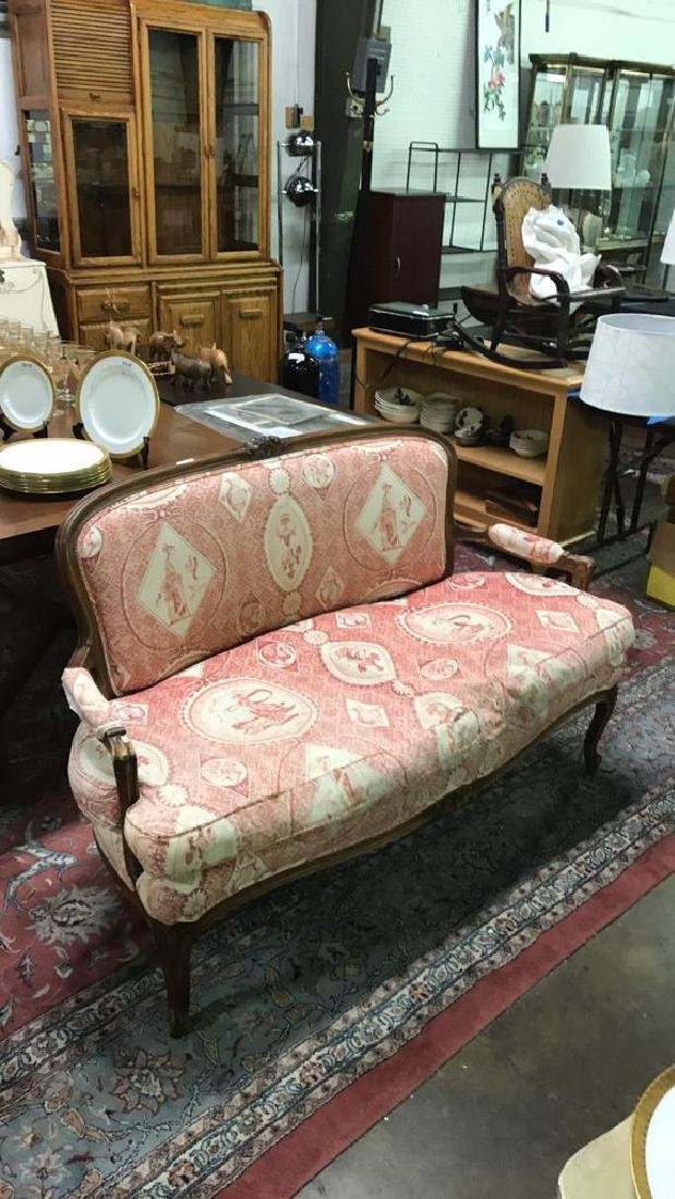 Red upholstered Victorian settee