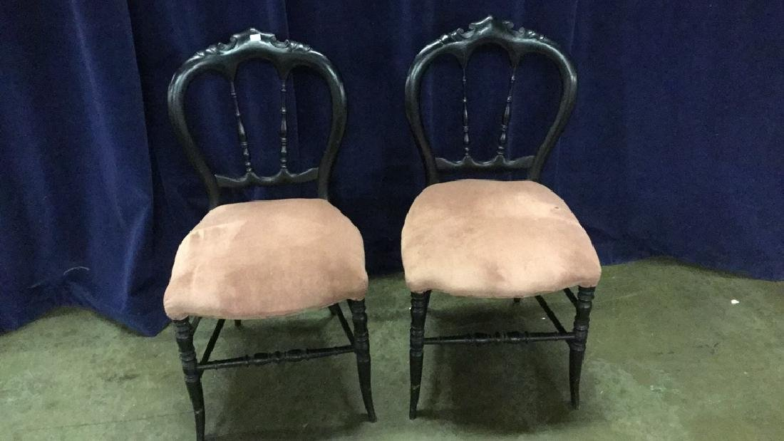 Two black Victorian side chairs
