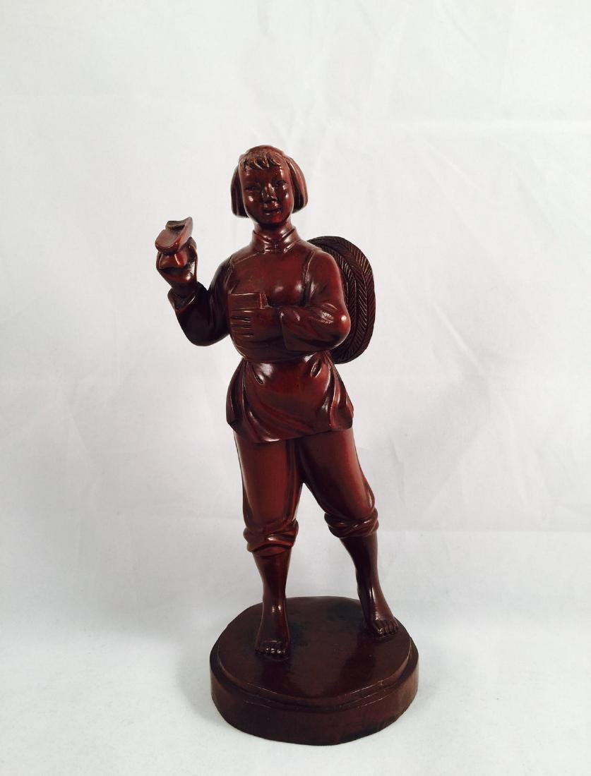 Chinese wood carving of woman