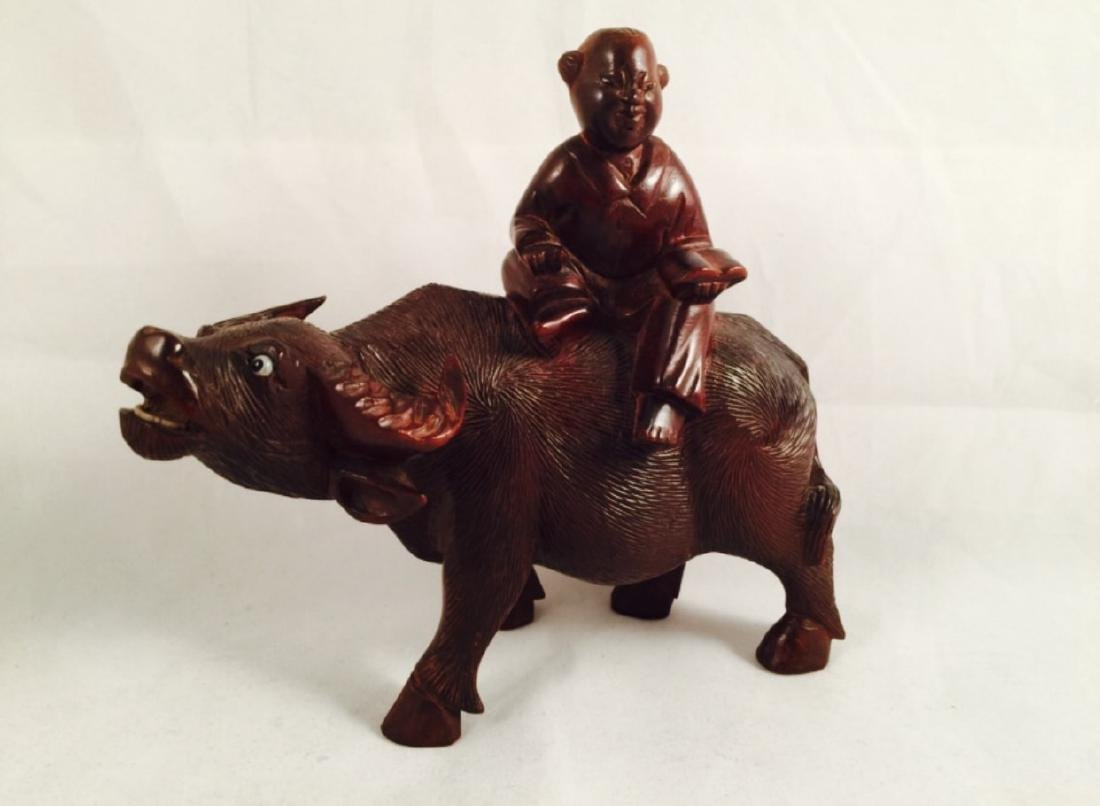 Chinese wood carving of boy and ox