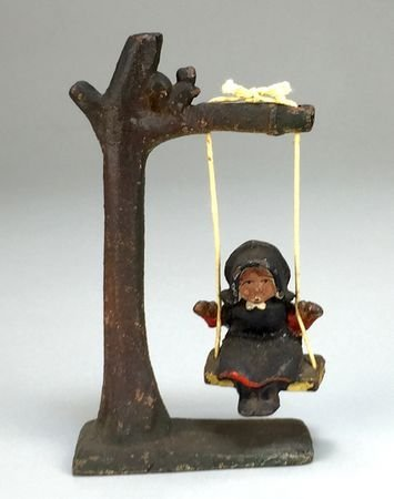 Vintage Cast Metal Amish Girl on Tree Swing