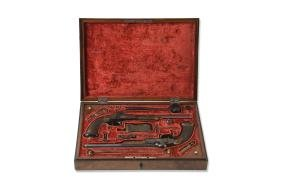 A pair of cased percussion duelling pistols