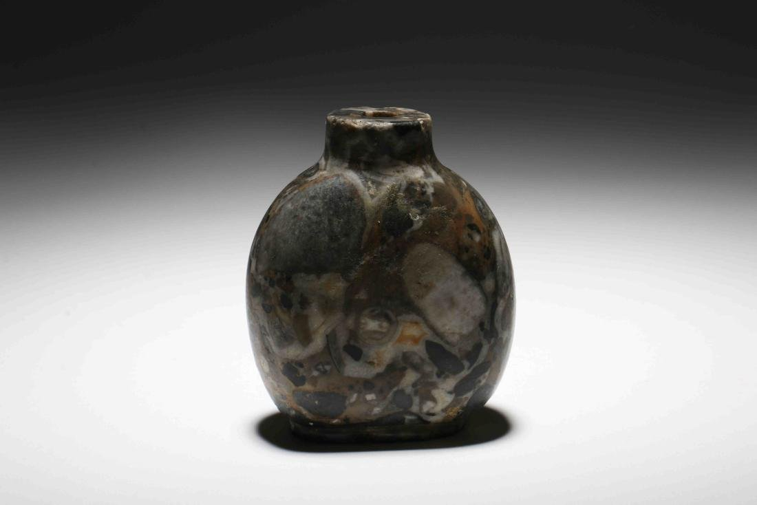 A Chinese Carved Stone Snuff Bottle