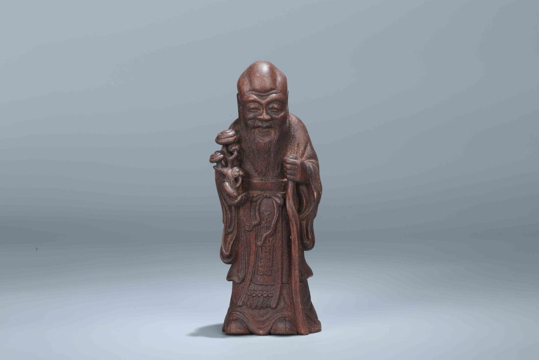 A Chinese Carved Wood Figure