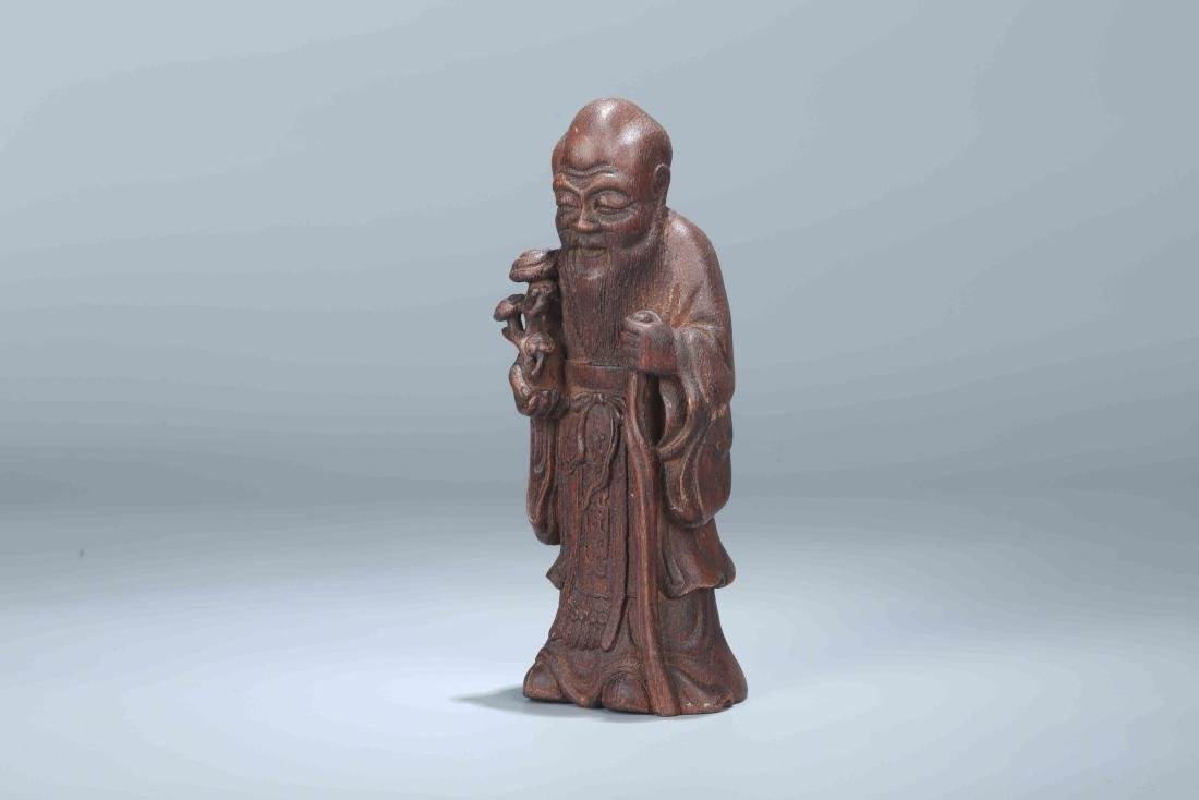 A Chinese Carved Wood Figure - 4