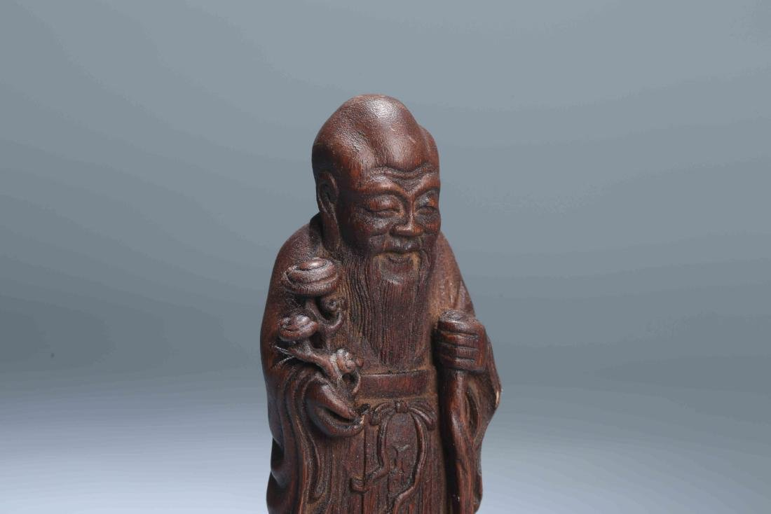 A Chinese Carved Wood Figure - 6