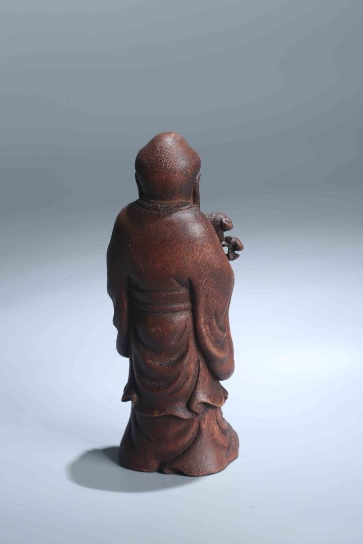 A Chinese Carved Wood Figure - 9