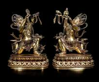 A Pair of Chinese Gilt Bronze Figures of Buddha