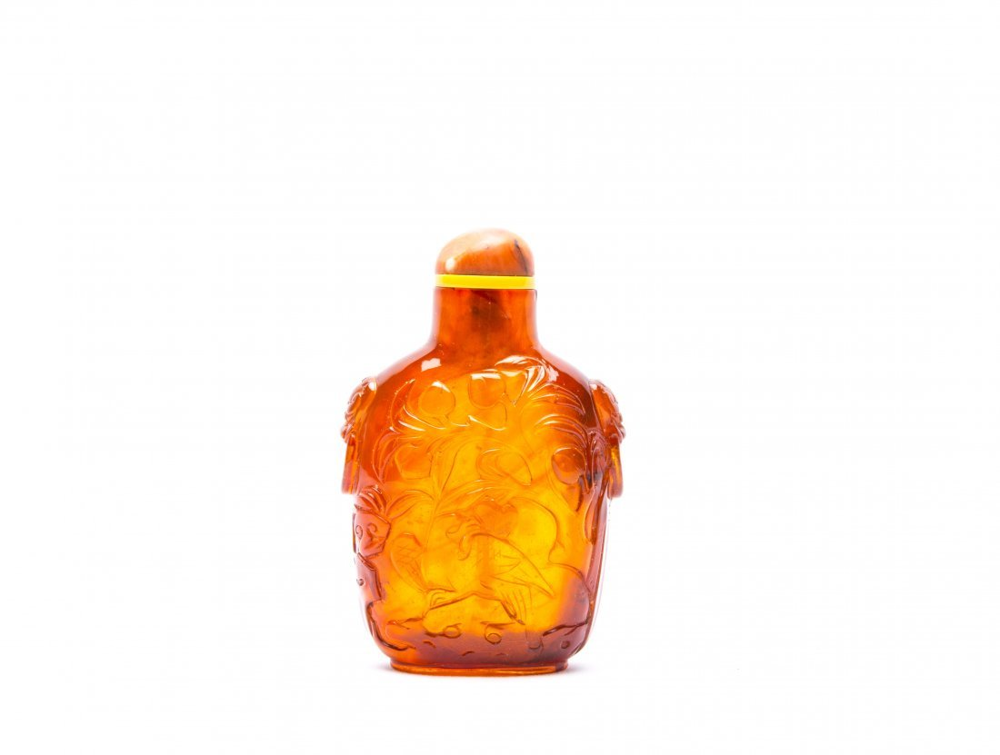 A Chinese Carved Amber Snuff Bottle