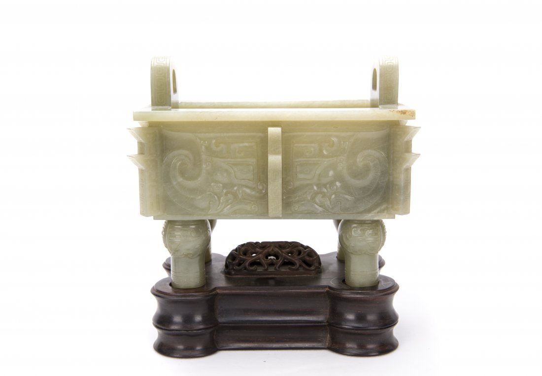 A Chinese White Jade Ding With The Stand