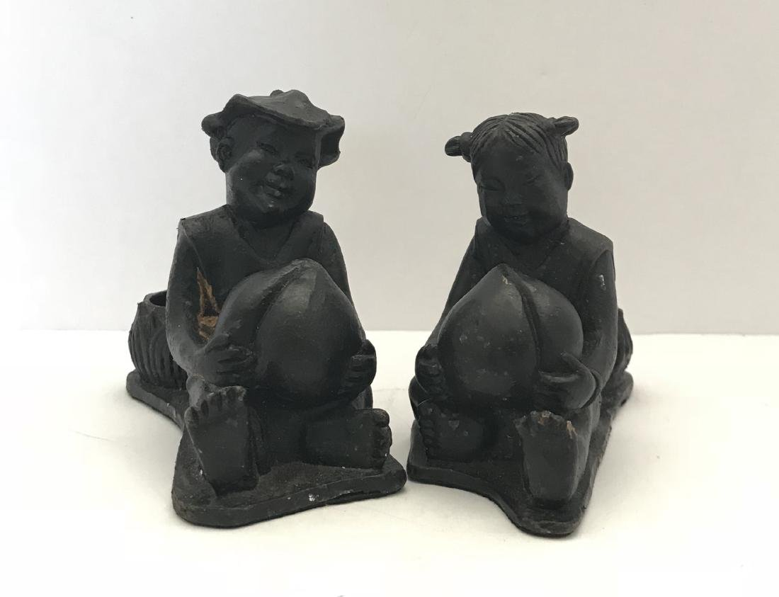 antique chinese pair cast in iron cande holders