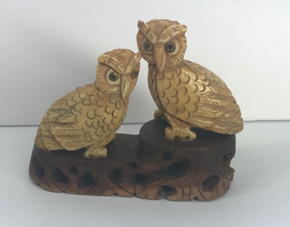 Hand carved animal figures over wood