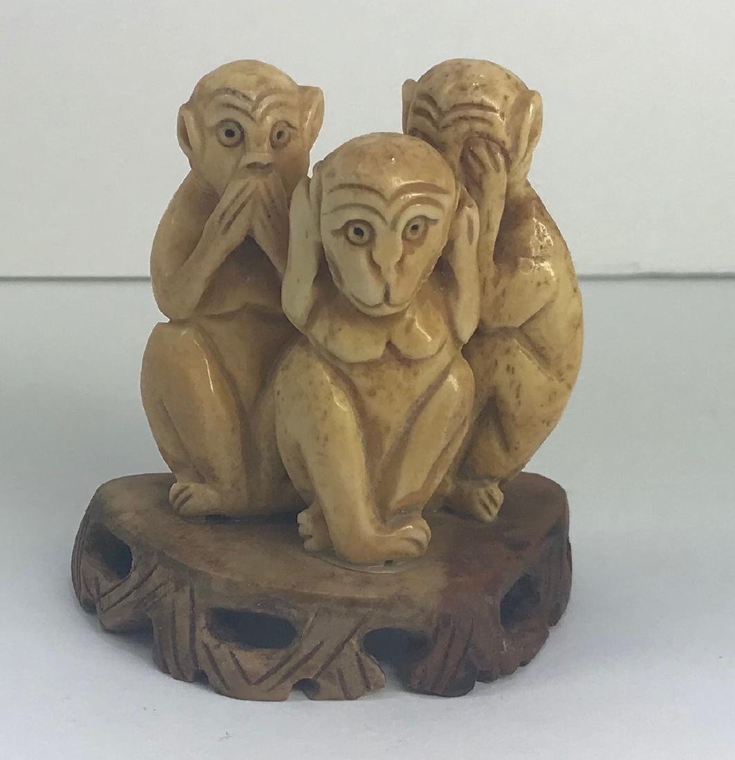 Three wise monkeys hand carved figure.