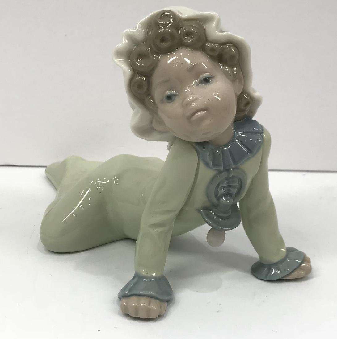 Lladro baby with pacifier crawling on the floor