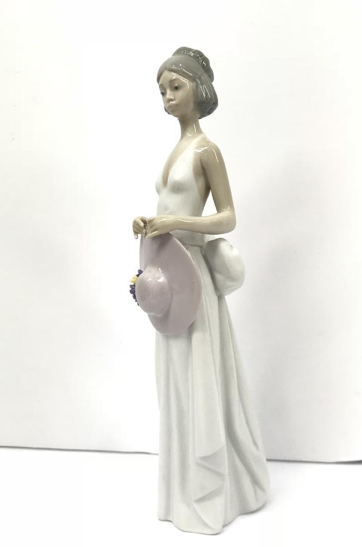 Lladro girl holding hat on hand