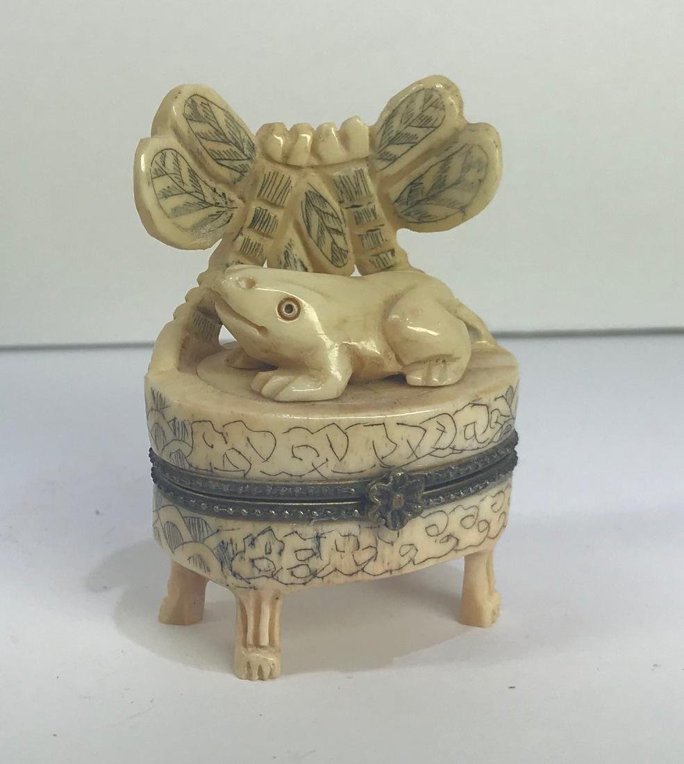 Hand carved frog figure on a seat
