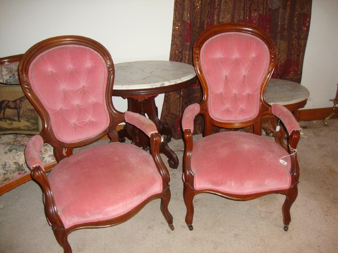 Pair of Walnut upholstered arm chairs