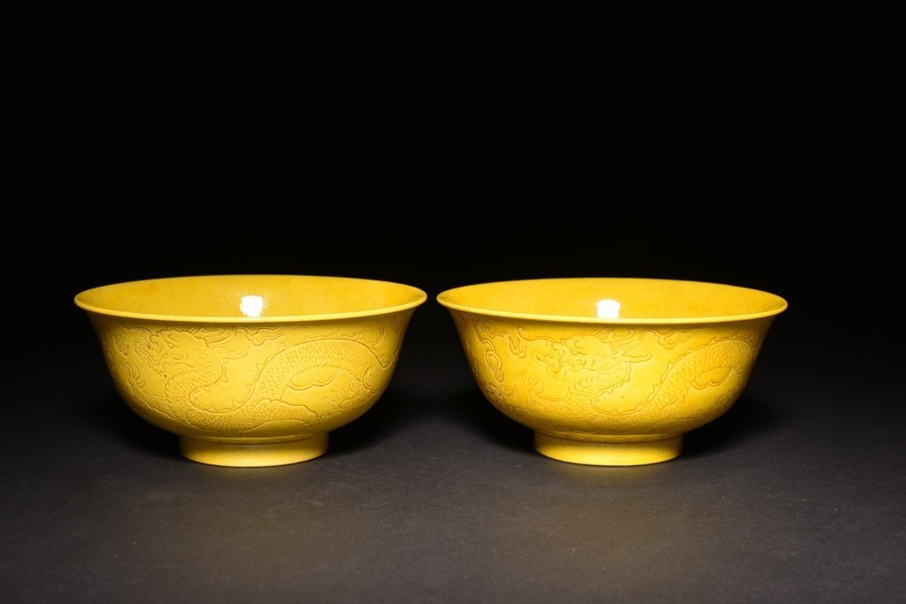 A PAIR OF CARVED YELLOW -GLAZED DRAGON BOWLS