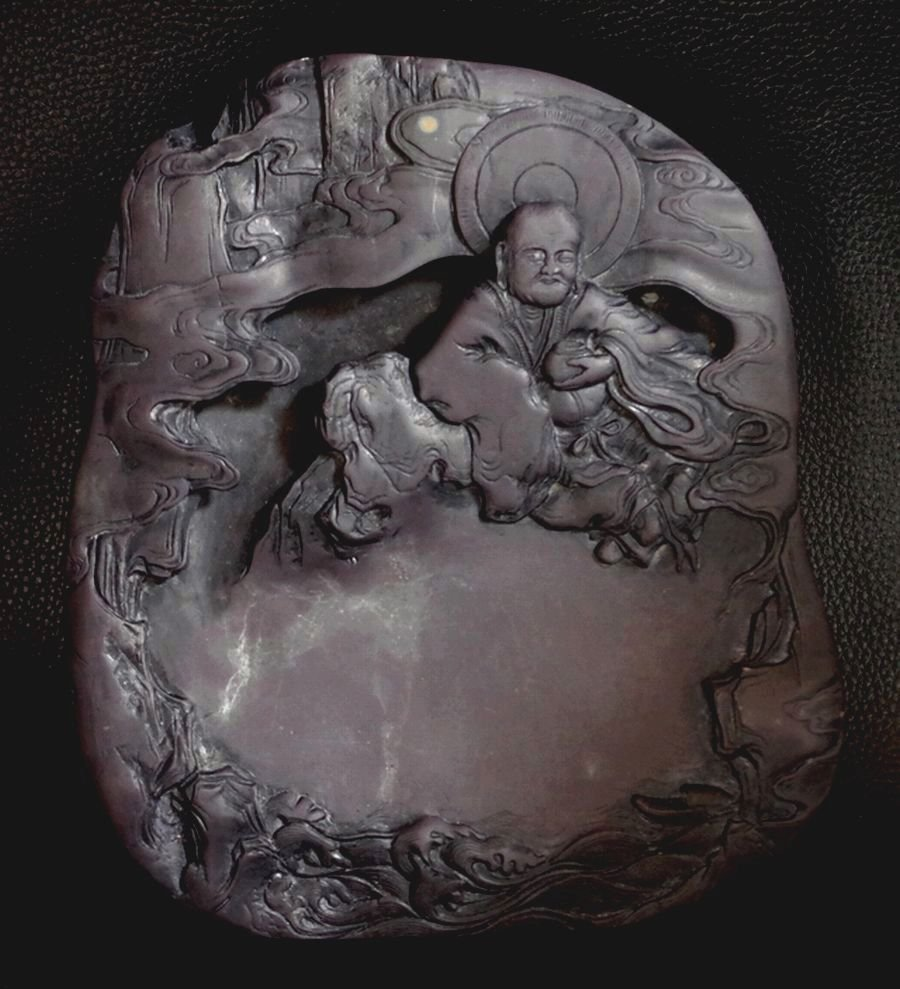 A CARVED DUAN INKSTONE  Arhat