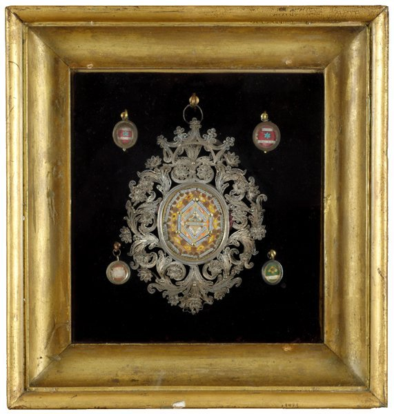 A framed reliquary containing the relics of 22 Saints.