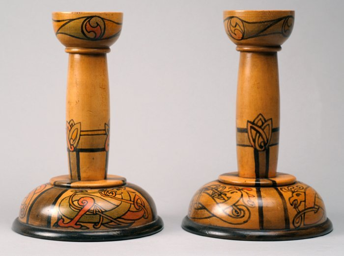 Pair of Irish Arts & Crafts candlesticks, by Cluna
