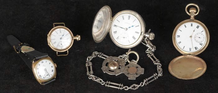 A Waltham & Co. half-hunter and other watches.