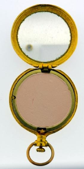Gold tone vintage compact with mirror and powder