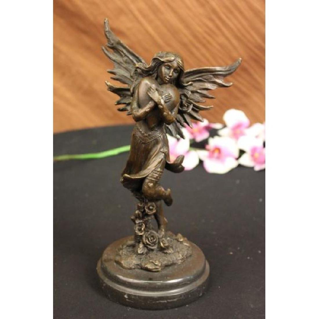Jean Patoue Young Fairy Clutches Giant Heart Bronze