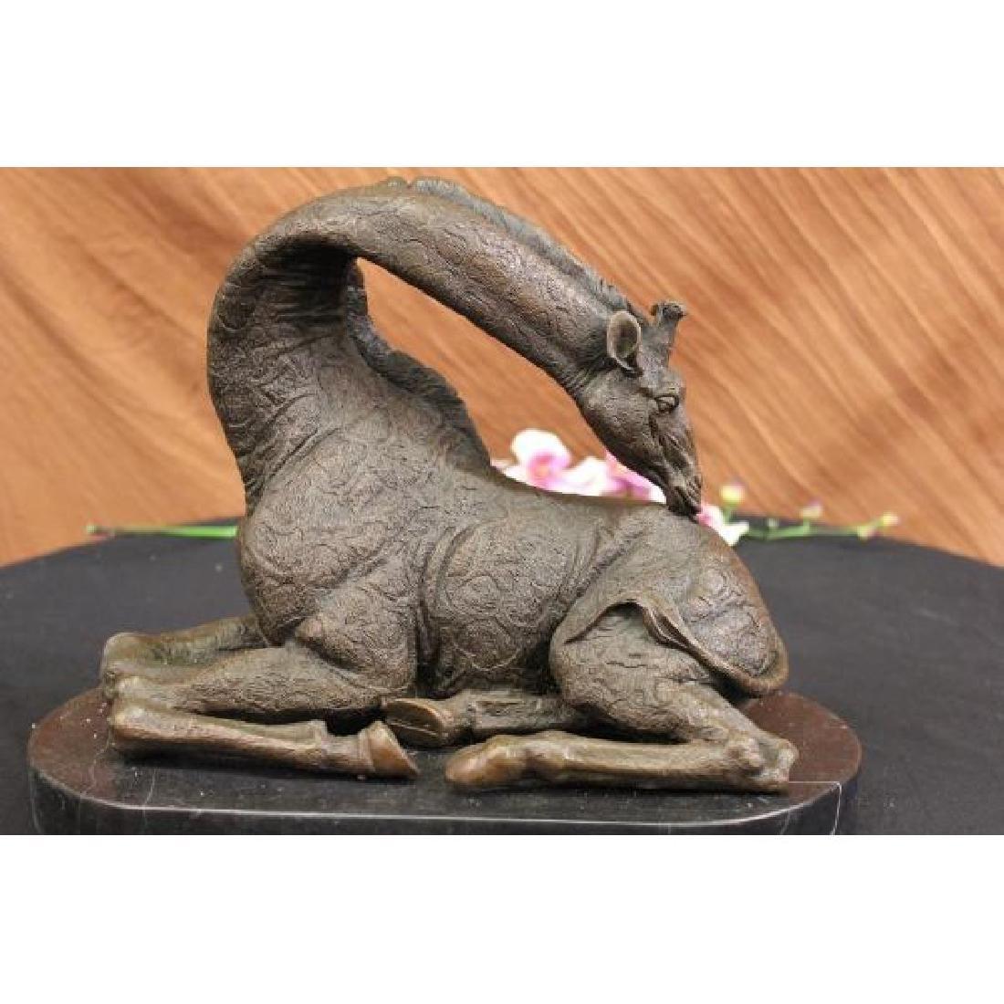 African Graceful Giraffe Sitting Bronze Sculpture